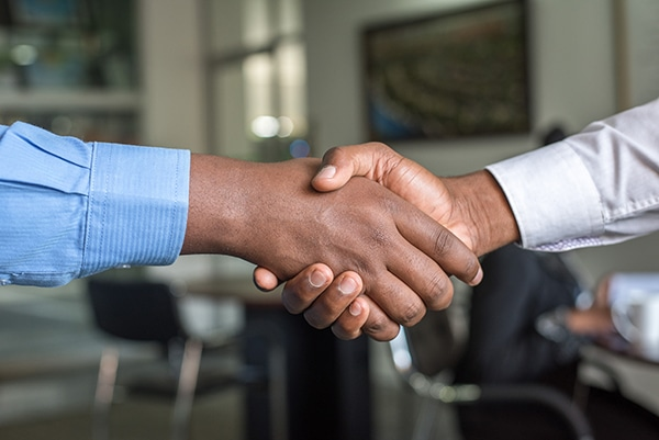 corporate move handshake